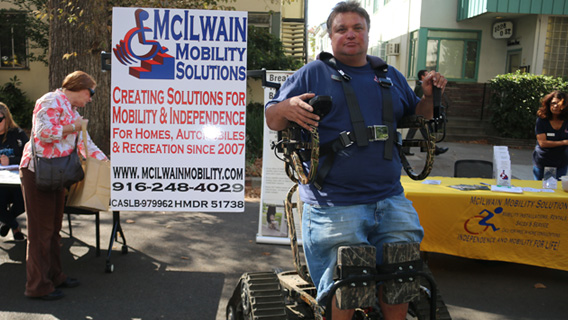 McIlwain Mobility Solutions display with all terrain piece of equipment.