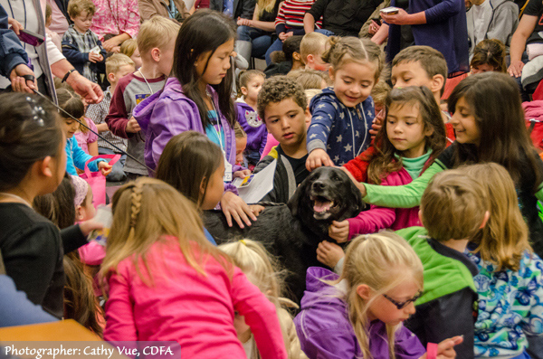 Detection Dog Bart surrounded by his young fans. (Photographer: Cathy Vue, CDFA)